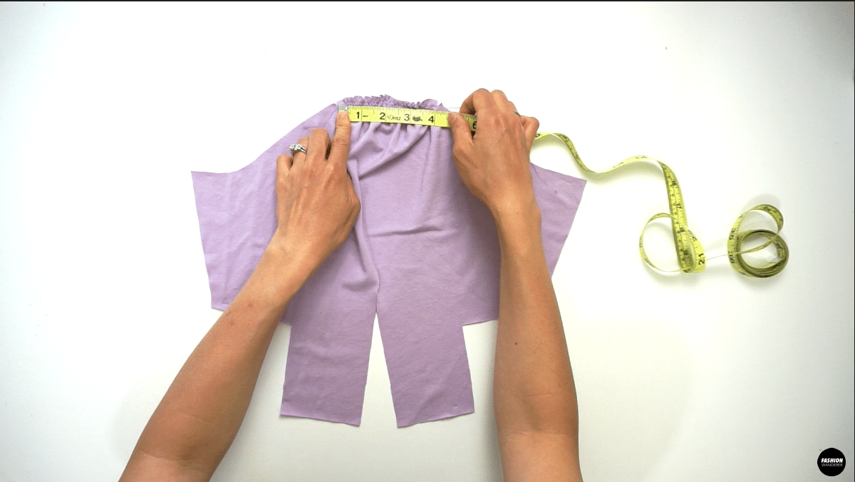 """Gently pull the back threads on each side so that the finished measurement will go from 8"""" to 4"""" long on top of the sleeve."""