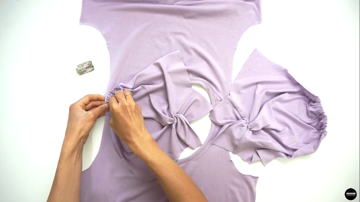 """Lay the bodice right side up and match the sleeve notch with shoulder seam, then pin along before you sew. Straight stitch ⅜"""" width and finish with overlock stitch."""