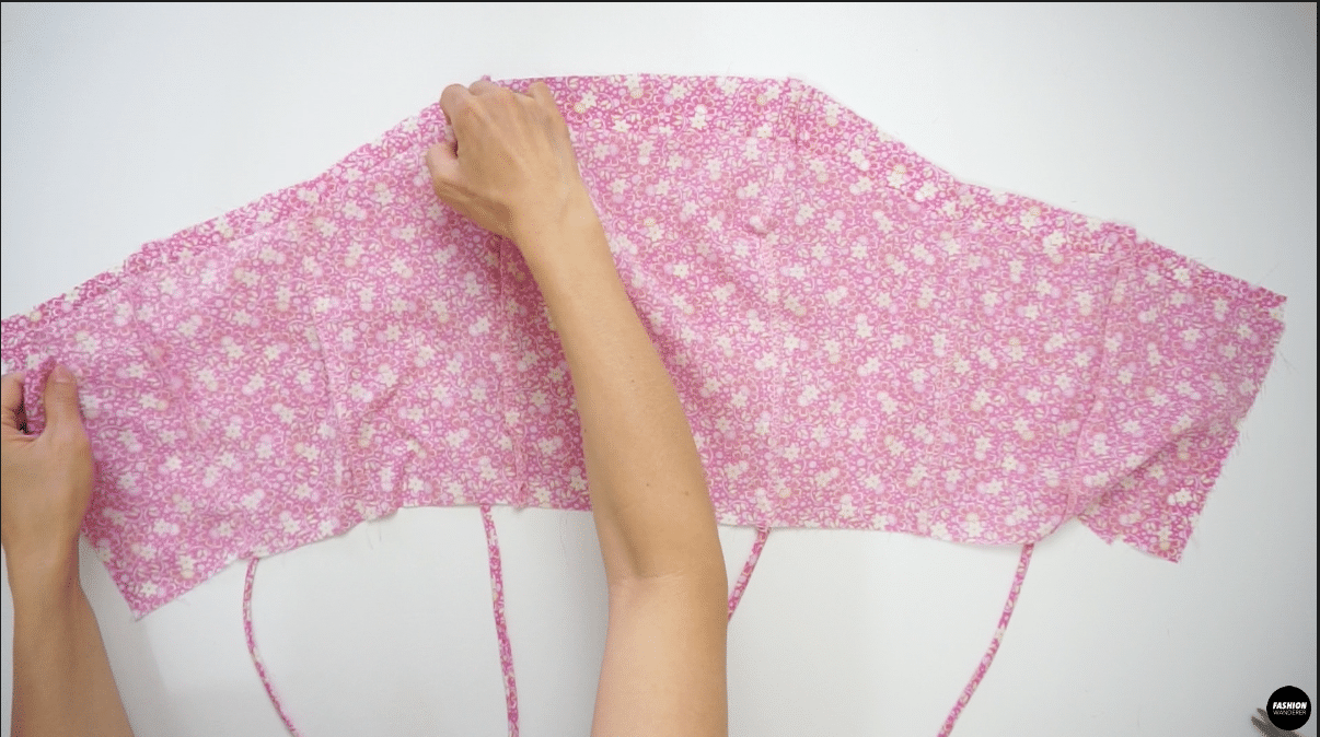 """Place the right side of the Top Lining piece and right side of the Outer Top piece facing each other and sew ⅜"""" straight stitch along the top edge from one side to the other."""