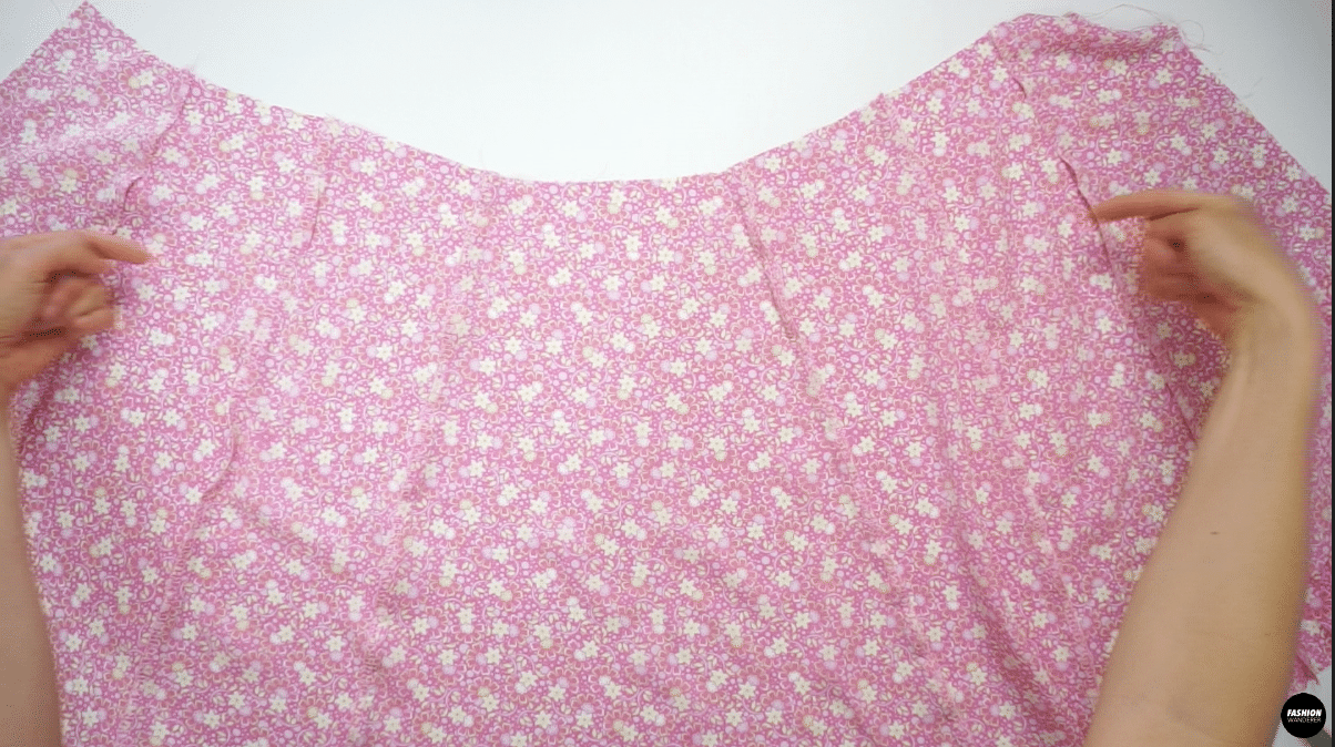 Finish the skirt seam with overlock stitch and press the seams in the same direction as the Top piece. The side seams of Side Front Skirt need to face away from Center Front, side seam of the skirt need to face toward the back skirt, and Side Back Skirt seam allowance need to face away from Center Back.