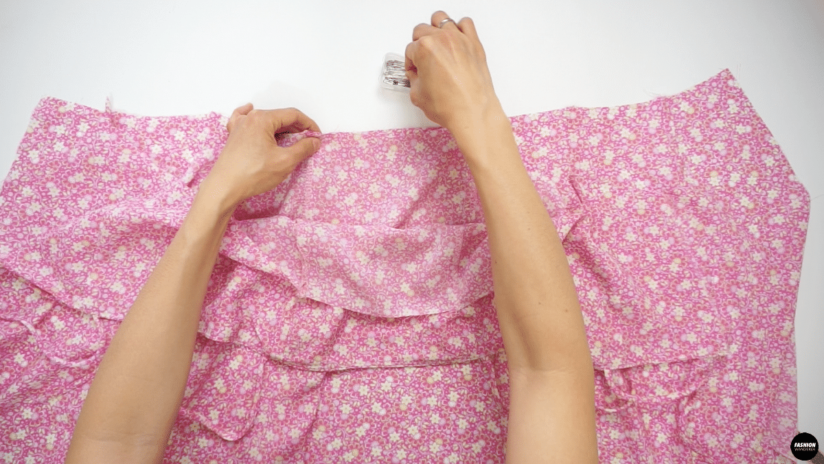 """Pin the right side of the Skirt and right side of the Outer Top piece together and sew ⅜"""" straight stitch along the waistline."""