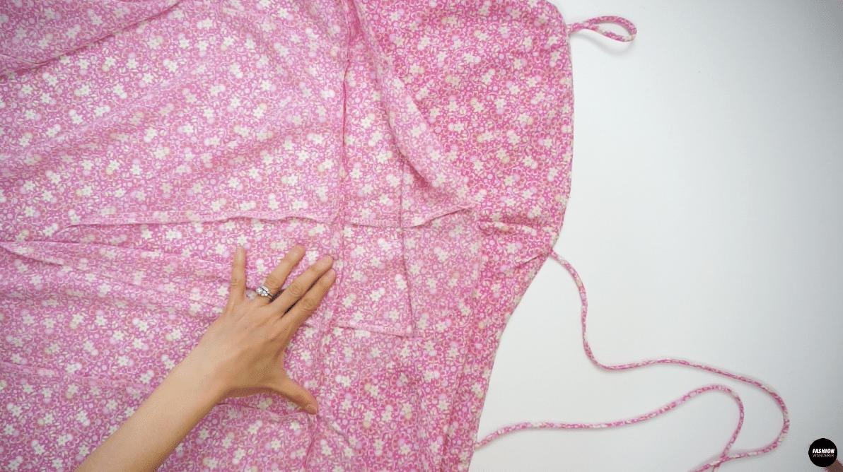 Fold the seam allowance facing toward the Top bodice.