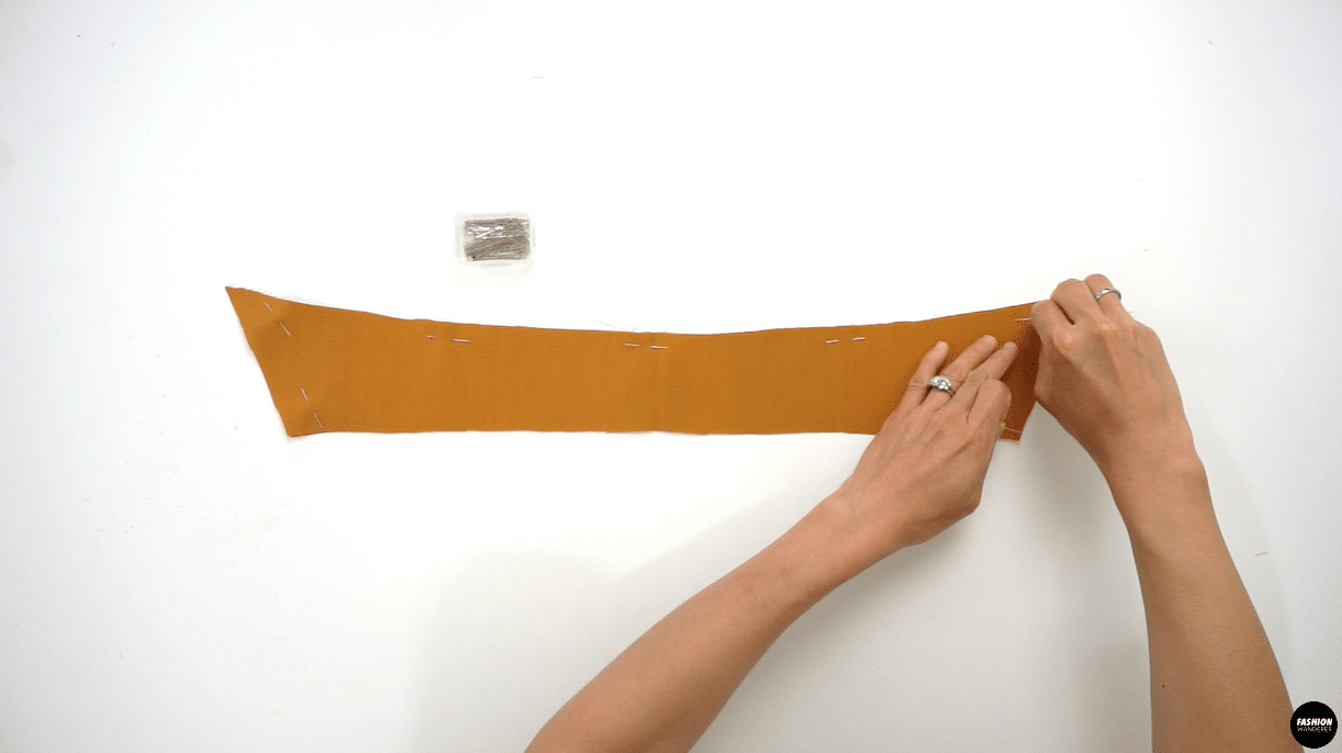 """Attach Upper Collar with fusible interfacing on the wrong side of the fabric. Place the right side of the Upper Collar and Under Collar facing each other, pin along the edges and sew ⅜"""" width seam allowance."""