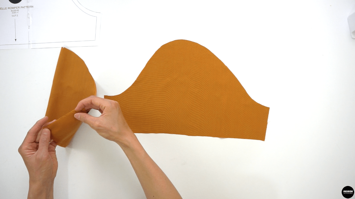 """Fold the Sleeve in half facing right sides towards each other and sew ⅜"""" width along seam allowance on the underarm seam. Finish with overlock stitch and press the seam toward the back of the sleeve."""