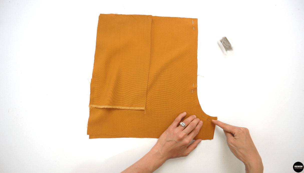 """Pin the Front Shorts together at the center front seams and sew ⅜"""" width along seam allowance, then finish the edges with overlock stitch. Do the same on the Back Shorts pieces."""