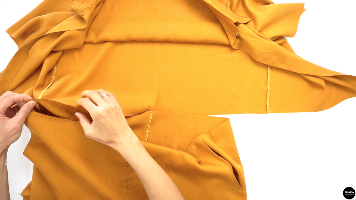 """Next, open the Top Bodice and pin along the waistline by pinning right side facing each other. Sew ⅜"""" straight stitch and complete with overlock stitch."""