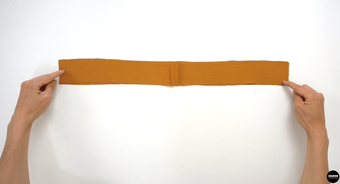 """Pull out 2 pieces of Waist Casing, place right side facing each other and sew ⅜"""" straight stitch on both ends. Press the seam open and then press the bottom edge with ⅜"""" width fold."""