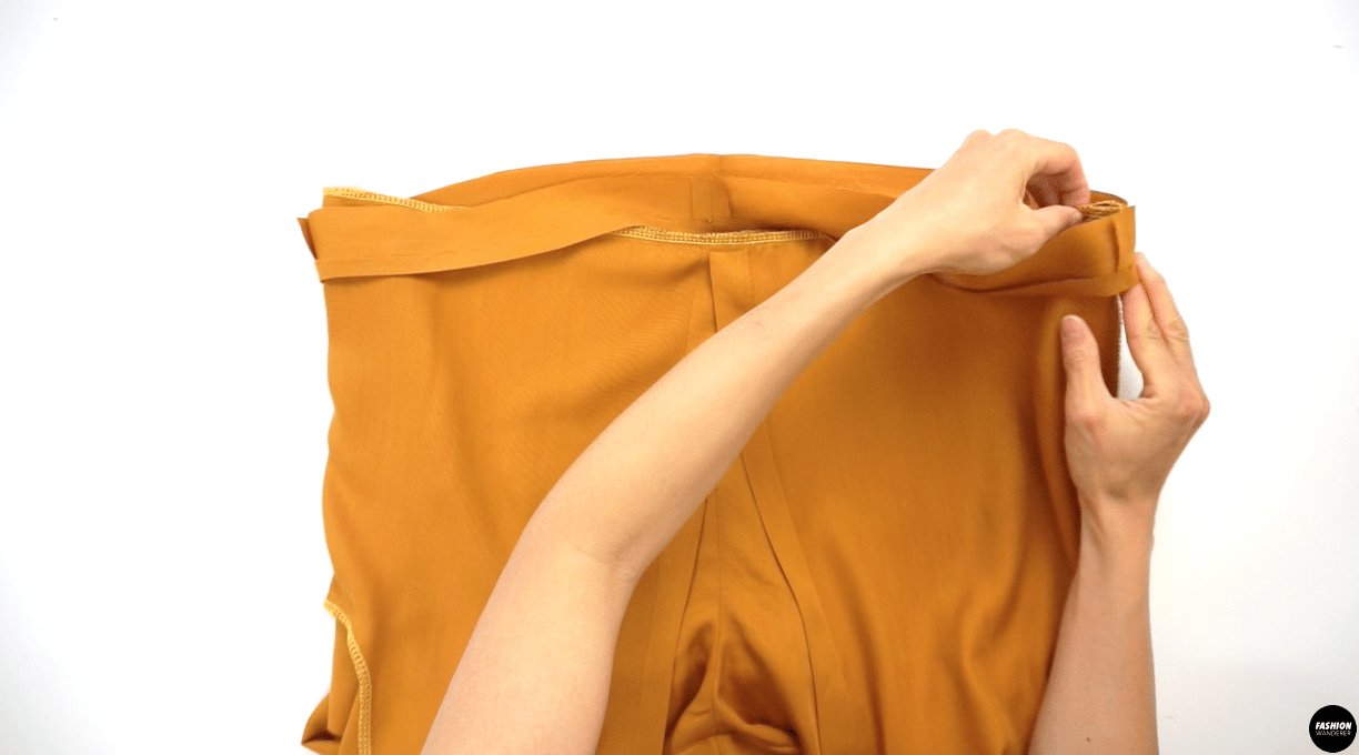 """Slide the Waist Casing piece through the Shorts and match the side seam and notches on front and back to pin. Sew ⅜"""" width along seam allowance and leave about 2-3"""" opening. Sew edge topstitch ⅛"""" width along the folded side of the Waist Casing."""