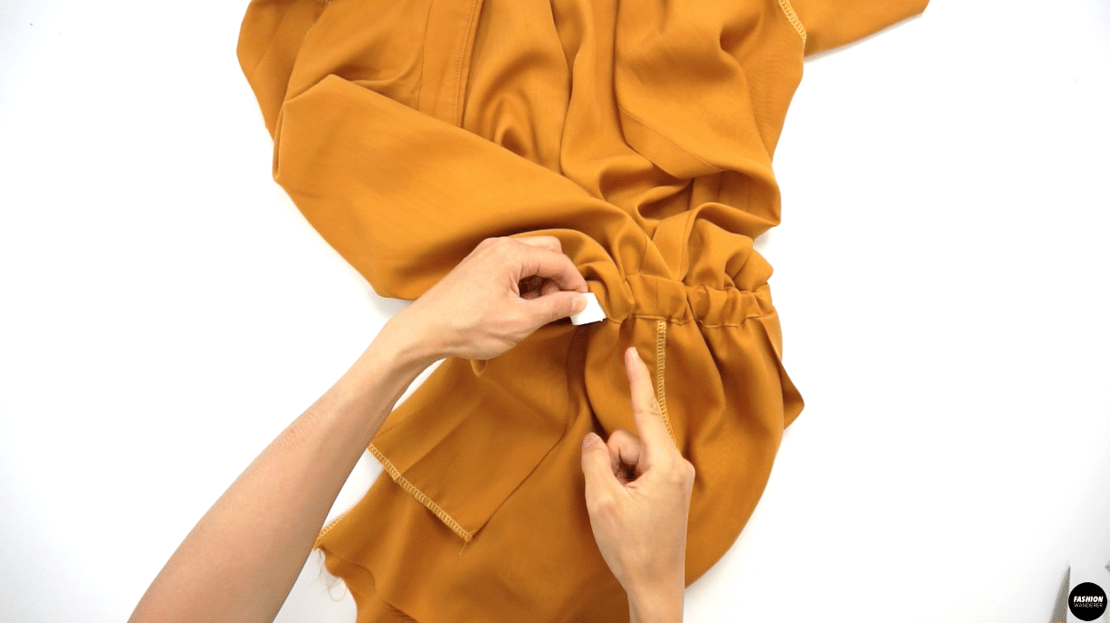 """Prepare 1 piece of 28½"""" long by ¾"""" width Elastic. Use safety pin to attach one end of elastic and slide through the tunnel of Waist Casing. Slowly push the safety pin until you reach the opening on the other side. Overlap the elastic about ¼"""" and straight stitch or zigzag stitch to join the elastic. After joining elastic, gently distribute the gathering around the waist and close the opening of the Waist Casing by edge topstitching."""