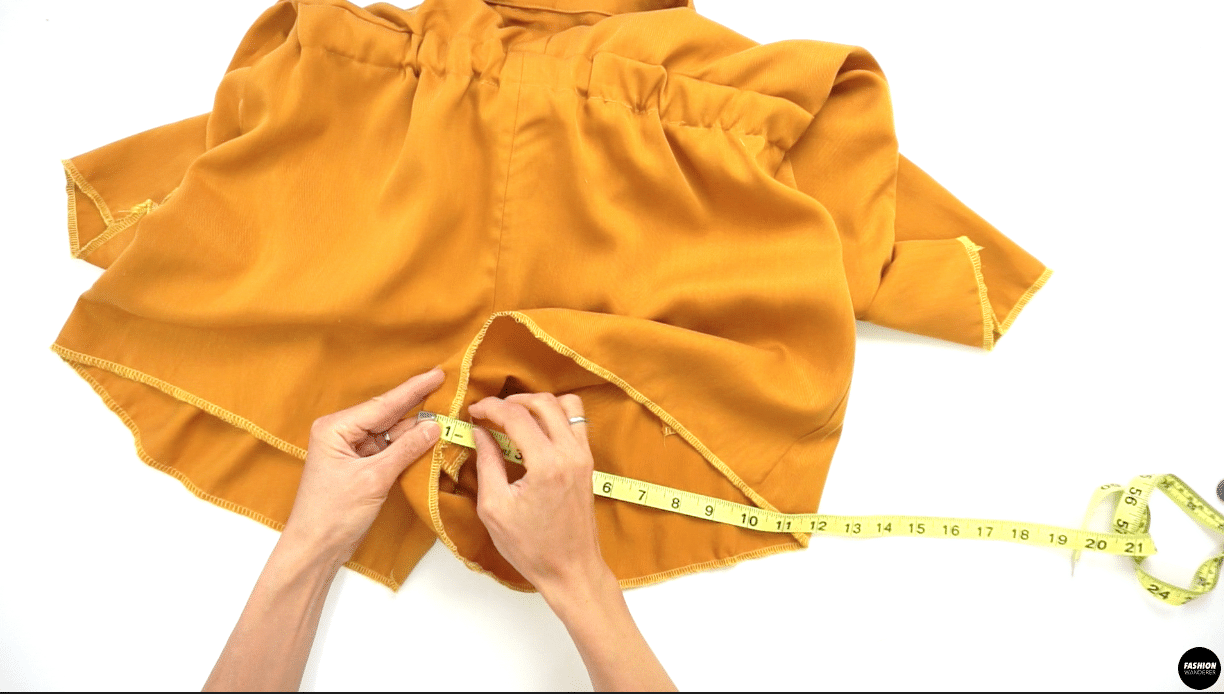 """Next, overlock stitch around the opening of the shorts. Again, fold ¾"""" width and press. Topstitch along the overlock stitch to create hemline around the shorts."""