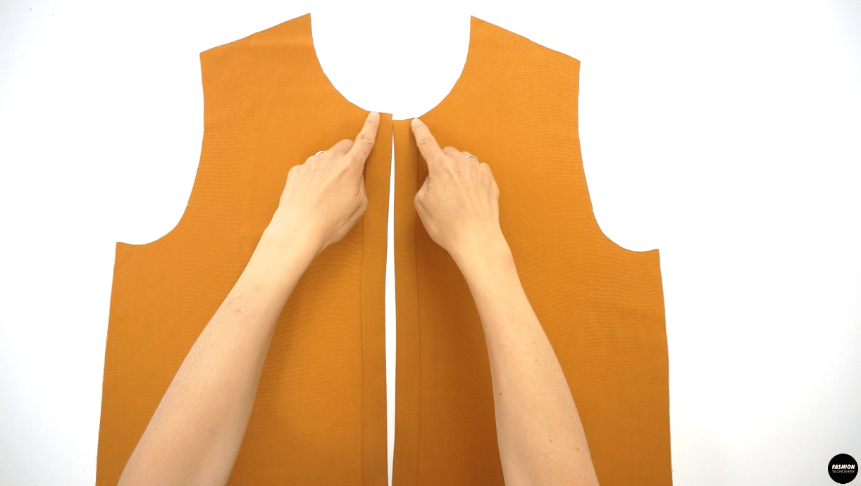 """Lastly, edge topstitch ⅛"""" away from the folded edge to secure the button placket on both bodice pieces."""