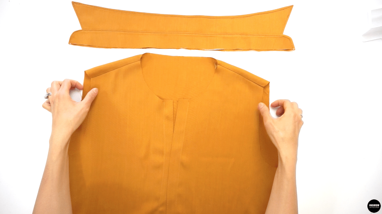 """Sew ⅜"""" width along the seam allowance and finish with overlock stitch. Press the finished seam facing toward the back bodice."""