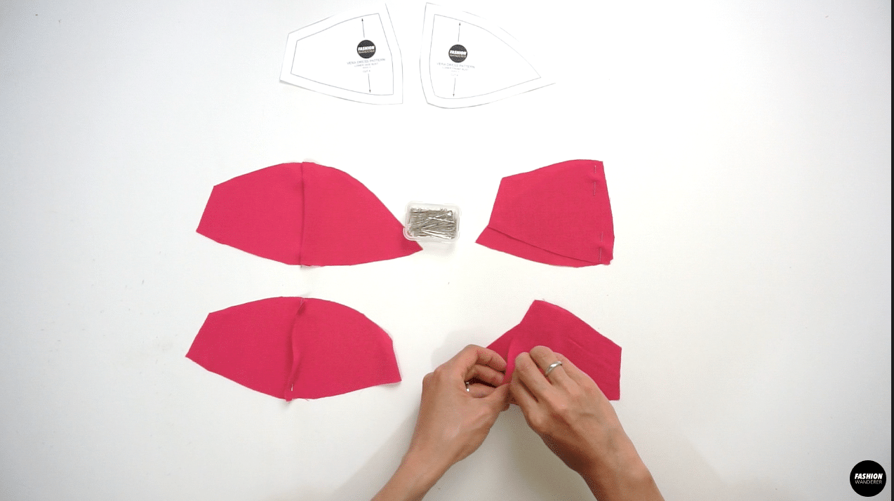 """Place the right side of Lower Side Bust and Lower Front Bust pieces facing each other, then ⅜"""" stitch along the seam allowance. Trim the seam allowance into ¼"""" width and press the seam open with iron."""