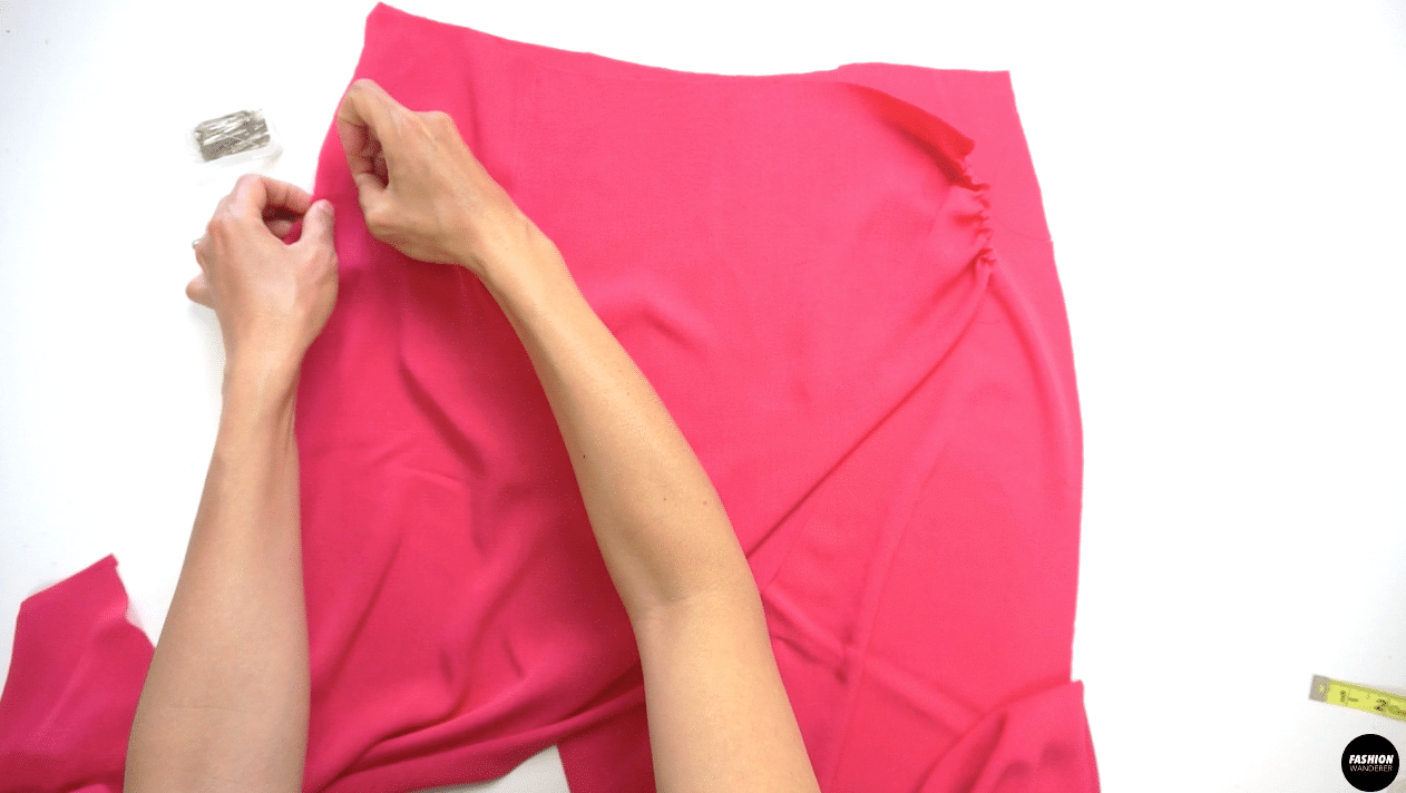 """Place the Front Right Skirt on top of Front Left Skirt, pin along the side seam and stay stitch ¼"""" width to secure both side seams."""
