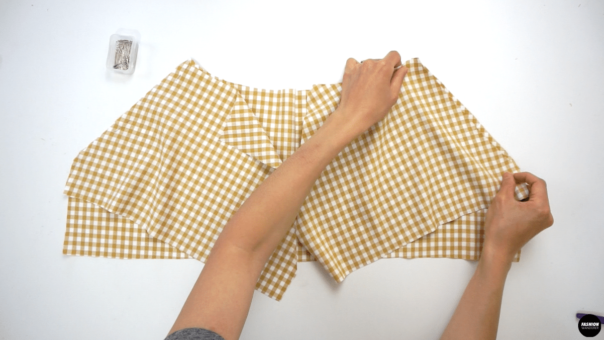"""Place right side of the Sleeve pattern to the right side of the Front Top facing each other, match the single notch in the middle and pin along the cut edge. Sew ⅜"""" seam allowance and finish with overlock stitch. Press the seam allowance toward the bodice."""