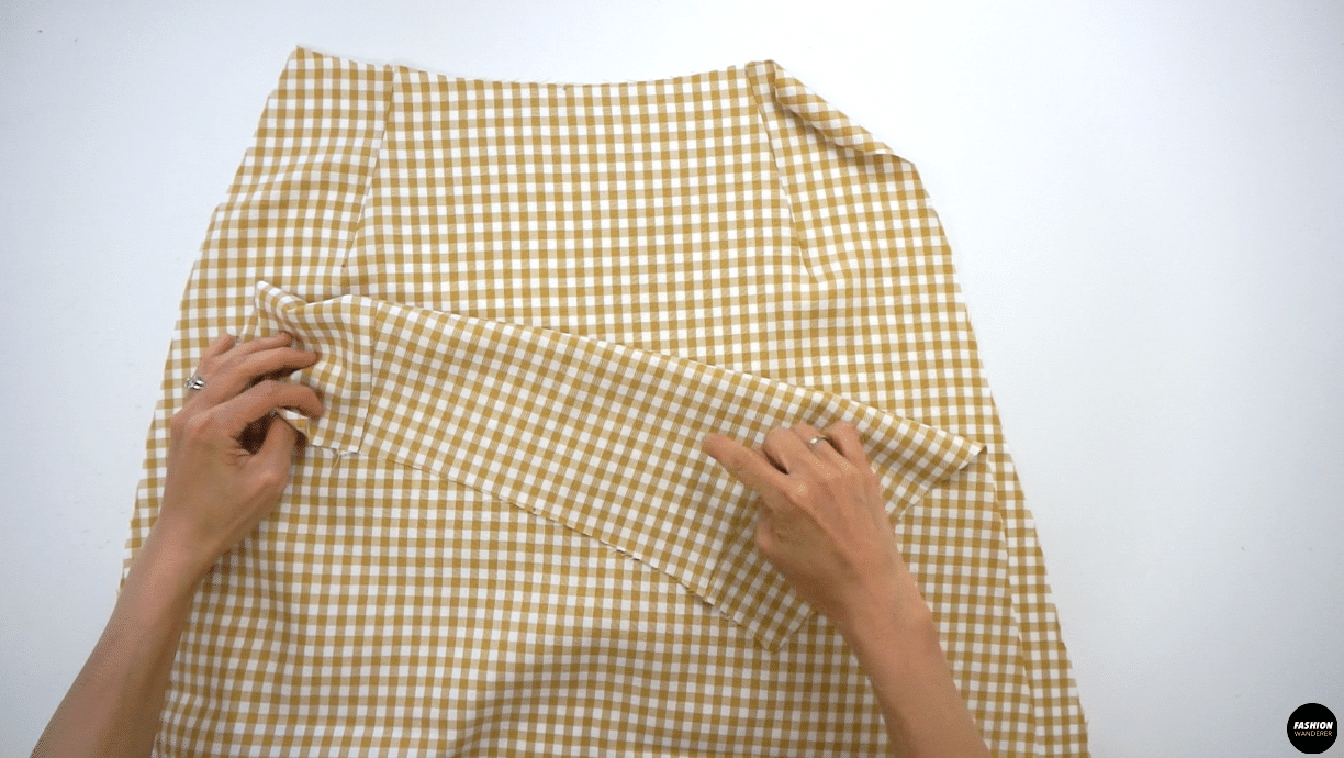 """Lay the right side of the Front Skirt and right side of Back Skirt facing each other. Sew the side seam on both sides with ⅜"""" straight stitch and finish with overlock stitch."""