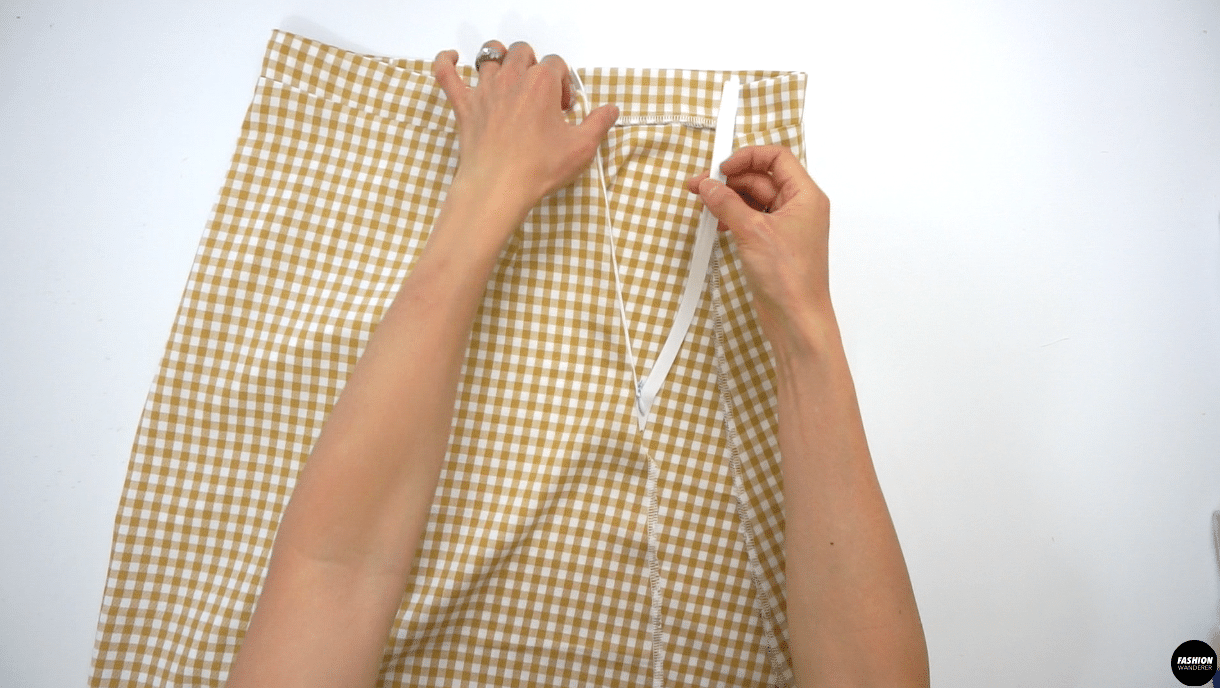 """Press the zipper tape and open the invisible zipper to place the right side of the zipper tape on the right side of the Front Skirt and sew ⅜"""" straight stitch with zipper foot. Next, place the left side of the zipper tape on the left side of the Back Skirt and sew ⅜"""" straight stitch."""