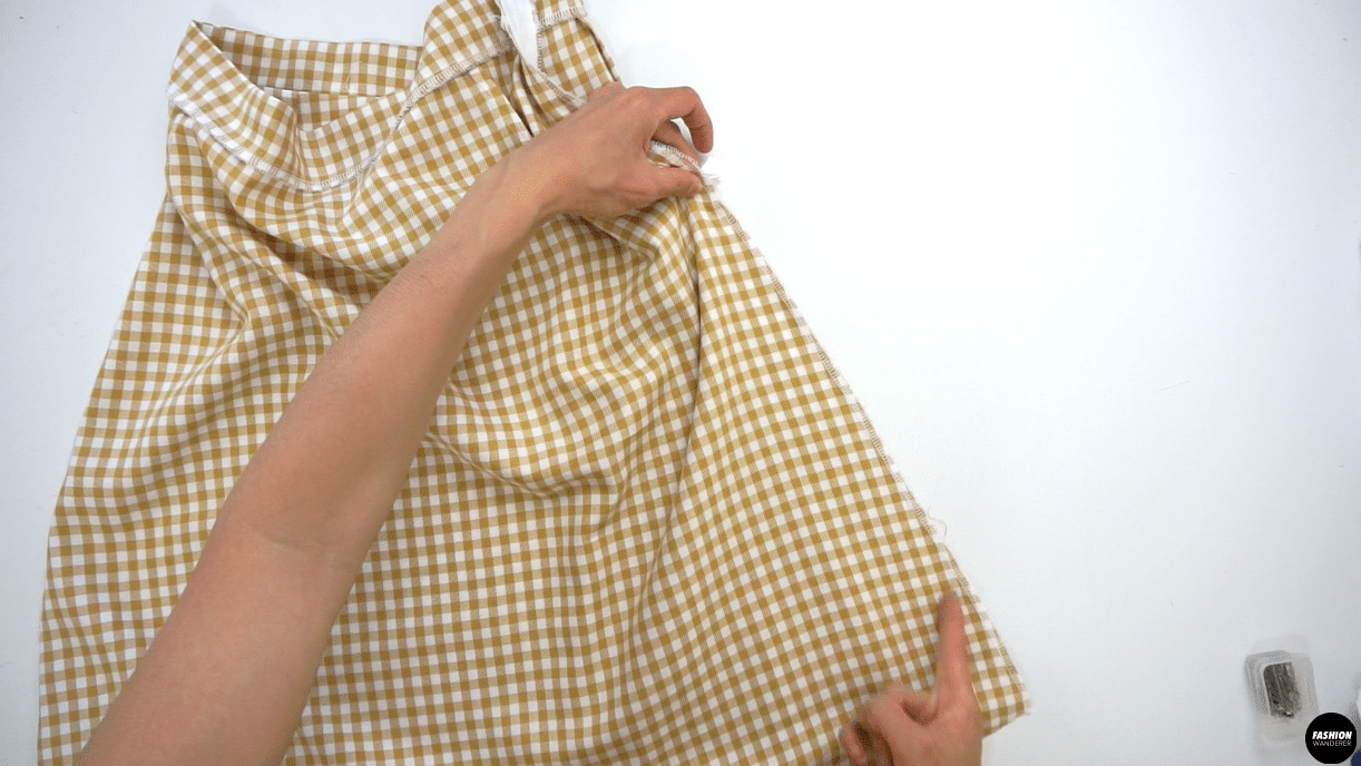 """Lastly, close the Left side seam with ⅜"""" seam allowance from the end of zipper to the hemline. Press the seam open."""