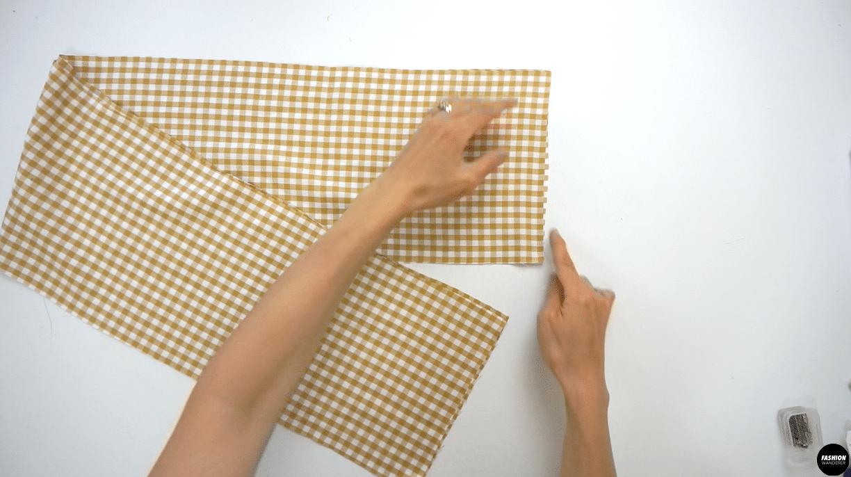 """Place the right sides of the Ruffle Hem Skirt towards each other and sew ⅜"""" width straight stitch and finish with overlock stitch. Press the seam on one side."""