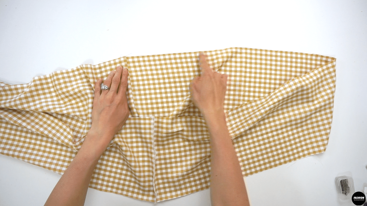 """Adjust the stitch length to 3.5 and double straight stitch lengthwise with ⅛"""" in between around the Ruffle Hem Skirt piece."""