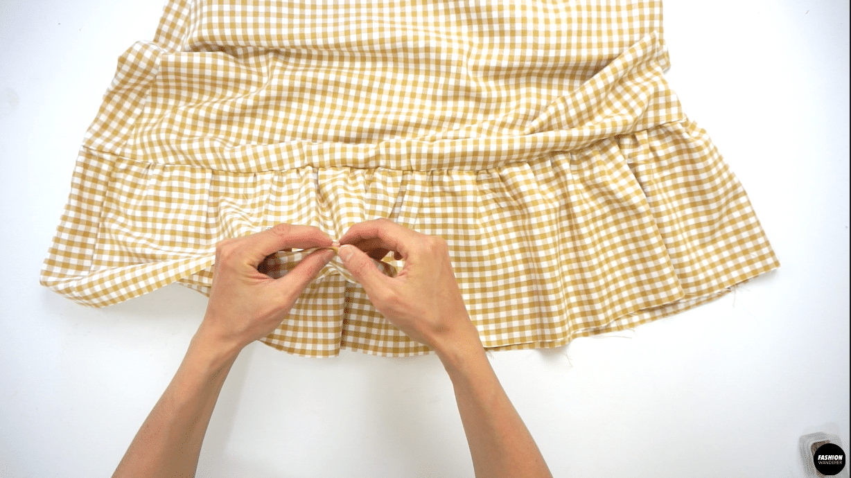 """Double fold the Ruffle Hem Skirt with ¼"""" width and straight stitch. Or you can use narrow hemming foot to make this finish even quicker."""