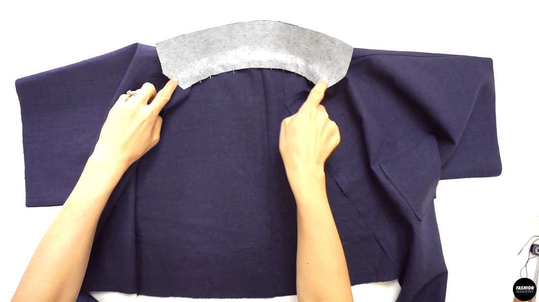 """Attach the Collar to the Top right sides together, and stitch matching the notches along the back neckline. Sew ⅜"""" width seam allowance and backstitch to secure both the start and finish."""