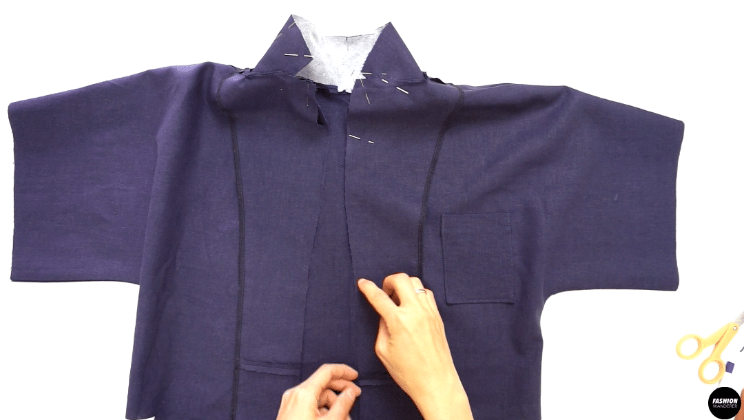 """Place the Facing and the garment right sides together matching up all cut edges and pin. Sew ⅜"""" width seam allowance starting at center back down to the hem on the Front Top. When you get to the point where the collar and lapel intersect, lower the needle, lift the presser foot and pivot the fabric."""