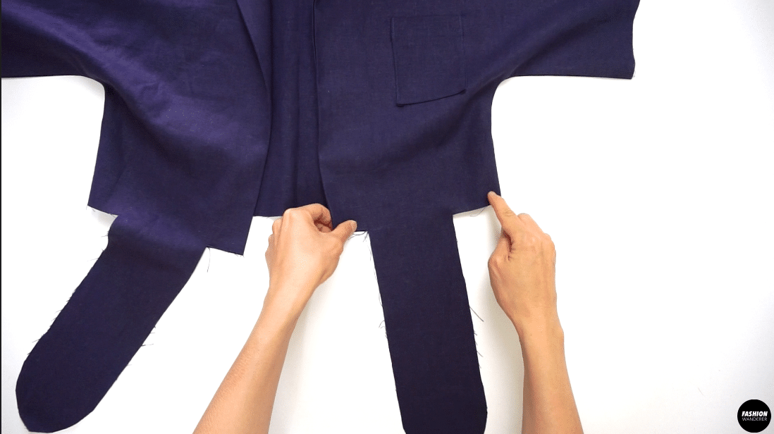 Overlock stitch the hem including the attached front tie piece and back opening.