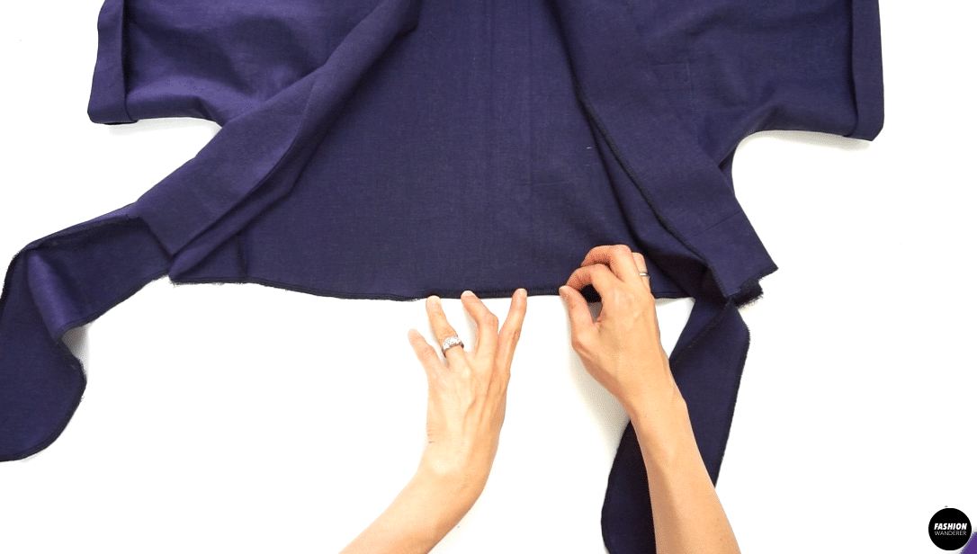"""Single fold the hem toward the wrong side of the fabric with ⅛"""" width seam allowance to finish. Press with iron to release the puckering."""