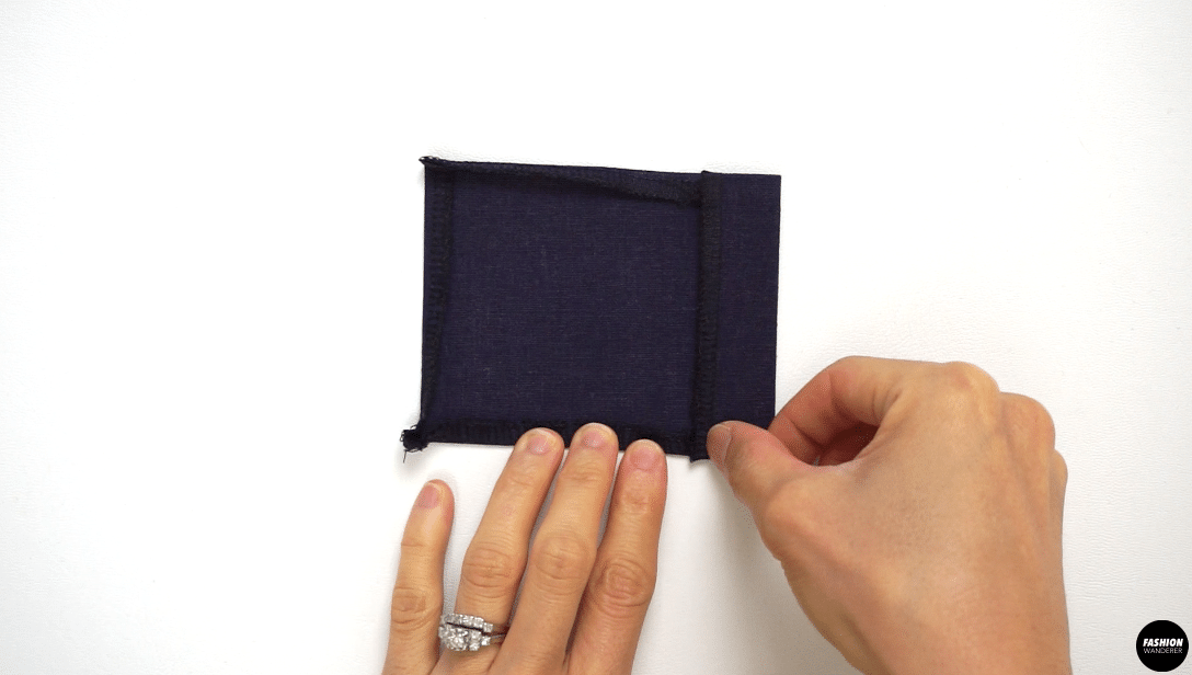 """Fold ¼"""" width on all three sides toward the wrong side of the pocket and press with iron. On the remaining side of the pocket, fold ¾"""" width and press with iron."""