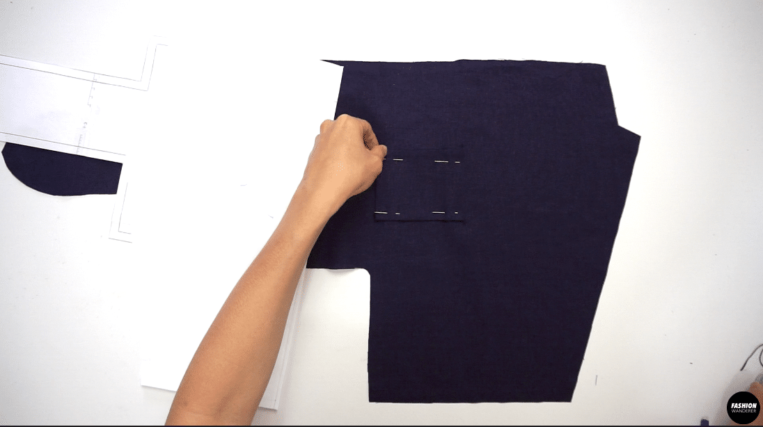 Place the Left Front Shirt facing right side up and transfer the pocket placement from the paper sewing pattern, then mark the four corners with fabric chalk. Position the Left Pocket piece and pin. Edge topstitch around 3 sides and leave the pocket opening. Press with iron.