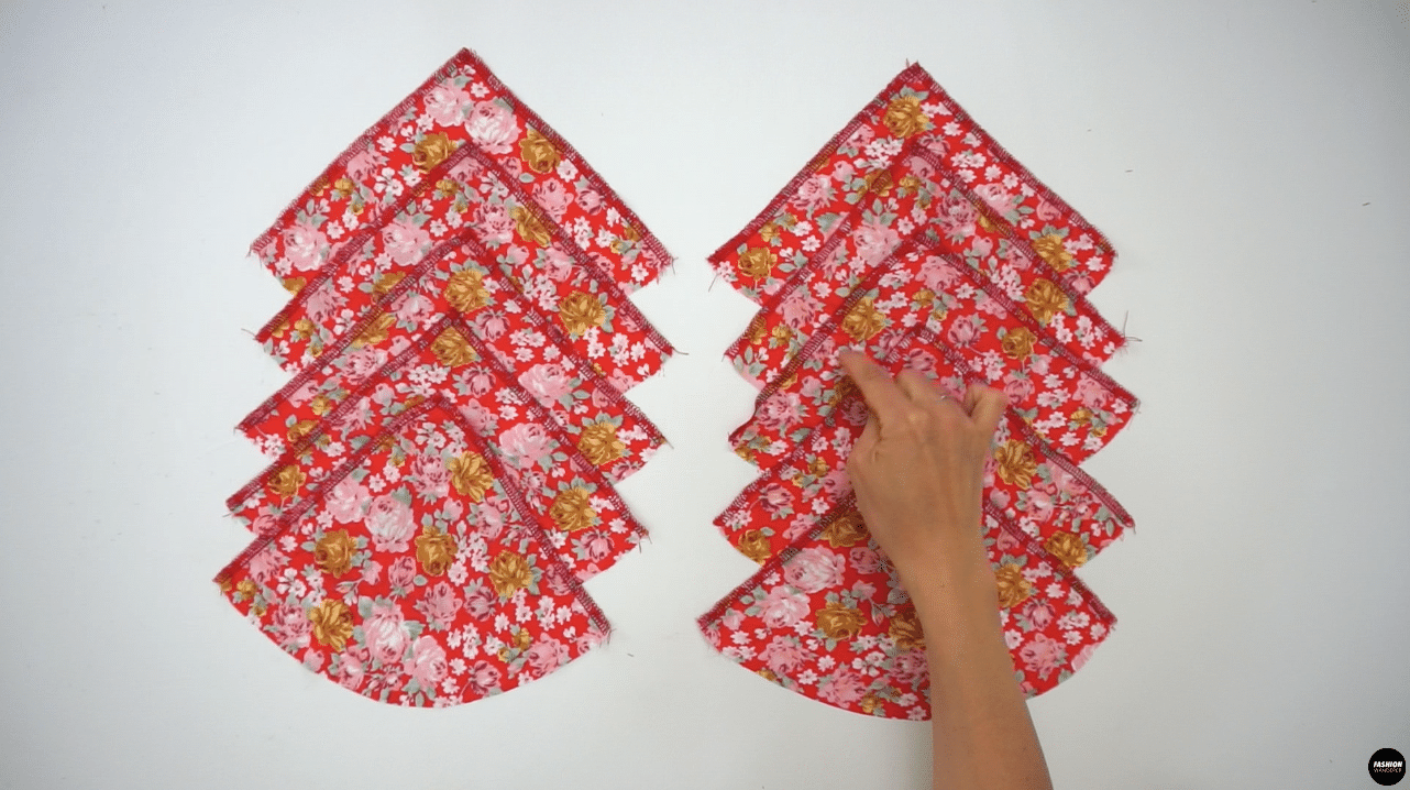 To finish godet pieces, start with the 10 pieces of Godet #1, and overlock stitch along both right and left straight sides; leave the curve cut edges as it is.