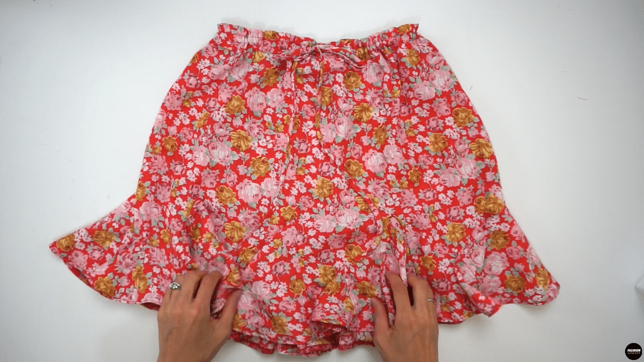 Adjust the gathering along the waist opening by tying a cute bow at center front to complete this Stella mini skirt. Give one last press all around and pair with any cropped length top as you wish.