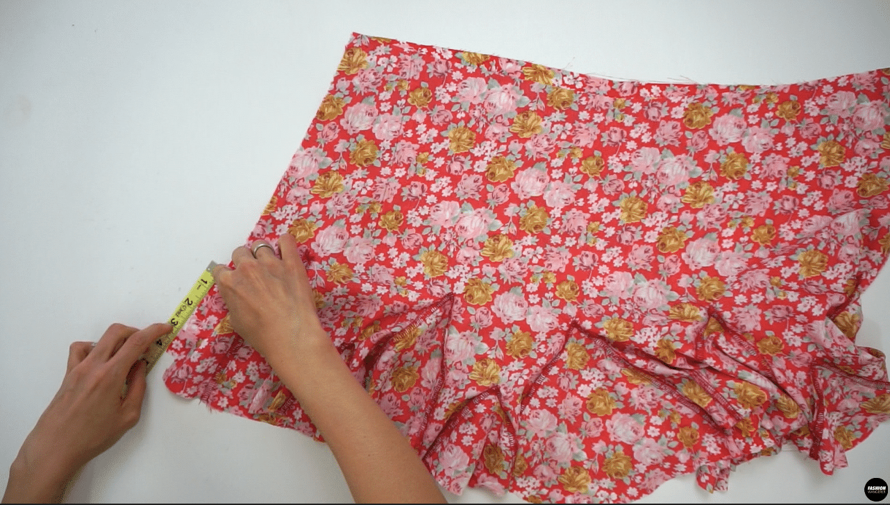 """Place right side of the Front Skirt and right side of the Back Skirt facing each other along the side seam. Measure 4"""" above the hemline and pin both pieces together. This will be your remaining Godet #2 locations. Do the same on the other sides. Sew the side seams with ⅜"""" width seam allowance."""